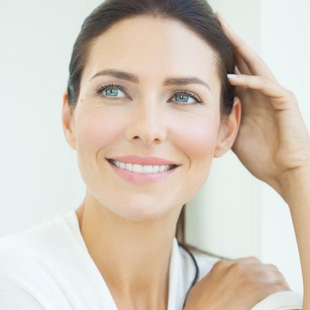 Image of a woman after getting veneers as part of Bellevue Cosmetic Dentistry
